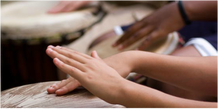 Amy Recchia Music Therapy Hudson Valley Close-up of hands playing african drums in a group.